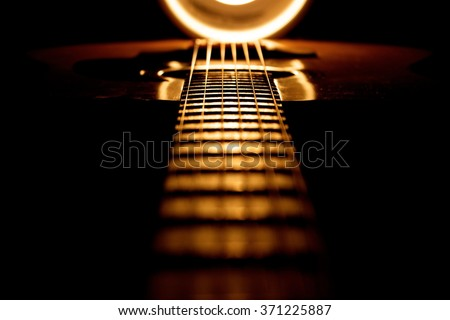 Dramatically lit guitar