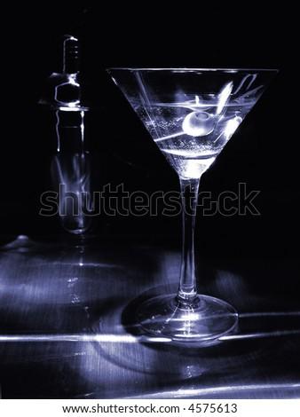 Dramatically lit martini in monotone blue.