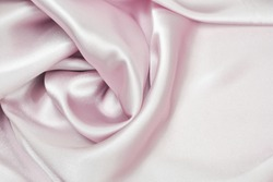 Draped satin and silk pink fabric for festive backgrounds