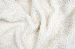Draped white artificial wool fur for background