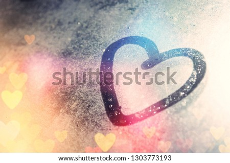 Draw a heart on the mirror with water drops and vintage use a background image to show the love, heart for love on valentine's day