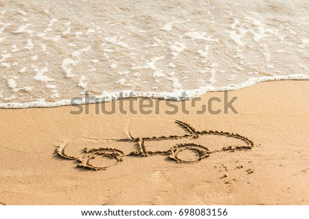 Draw car on beach sand. Conceptual design. Picture of car on the sand.car drawing in the sand near sea. Space for text