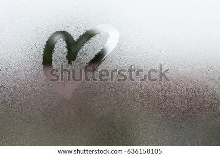 Stock Photo Draw the heart on vapor at the glass