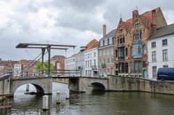 Drawbridge in Bruges, Belgium. Traditional bride over canal in Brugge.