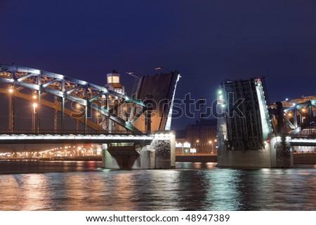 Drawbridge in St. Petersburg. Name of the bridge - Bolsheokhtinsky. Night photo