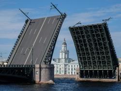 Drawbridge in St. Petersburg, Russia. The Kunstkamera building between the openings of the bridge.