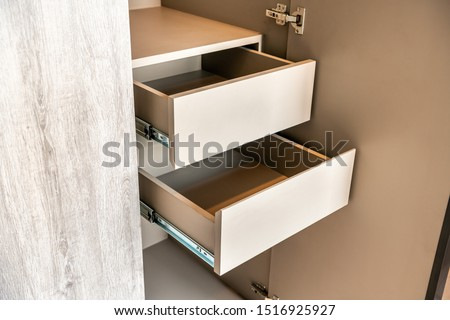 Drawer in a cabinet in a bedroom close-up with nothing inside Foto stock ©