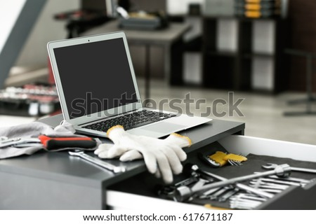 Drawer unit with laptop and tools in car repair shop