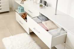 Drawers with clean clothes in dressing room