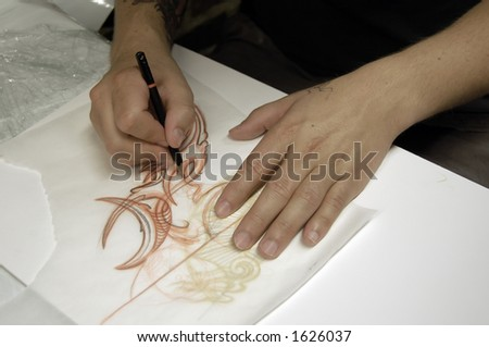Drawing a tattoo. assistant