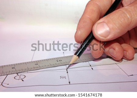 drawing and work, ruler and pencil in the hands of an engineer at the workplace, workplace concept on the technical drawing, structure and construction #1541674178