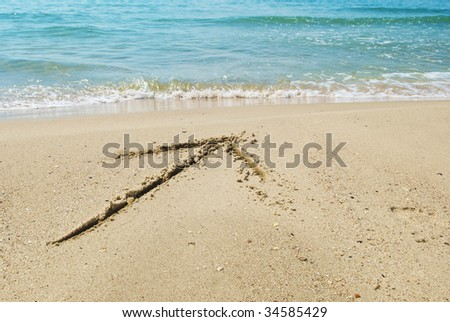 drawing arrow on sand
