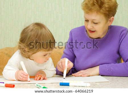 Drawing baby with her grandma at home