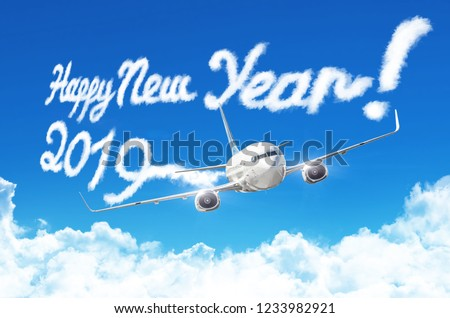 Drawing by airplane vapor steam contrail in blue sky. Happy New year concept #1233982921