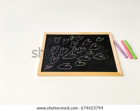 Drawing cartoon heart,colorful chalk spread on white background.  #674423794