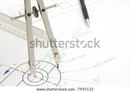 drawing circle with a compass on a blueprint