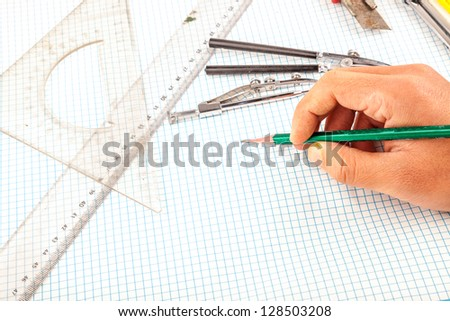 drawing compass in the wooden table