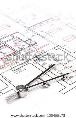 Drawing compass on architectural plan