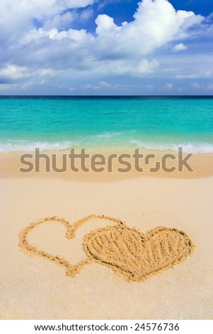stock photo : Drawing connected hearts on beach, love concept