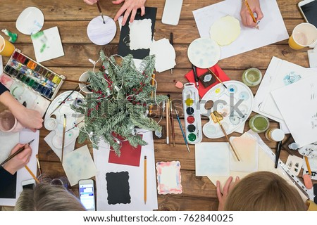 drawing, creativity, illustration concept. top view of the work table of artists and illustrators with watercolores, brushes, sheets of paper and wonderful branch of conifer tree #762840025