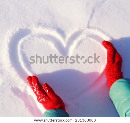 drawing heart on snow, love winter