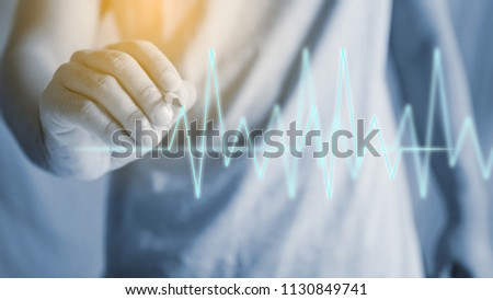 Drawing heartbeat graph. healthy concept                                #1130849741