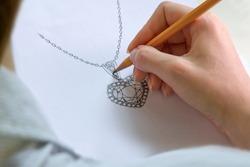 Drawing Jewelry Design. Drawing sketch jewelry on paper . Design Studio. Creativity Ideas.