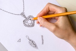 Drawing Jewelry Design. Drawing sketch jewelry on paper . Design Studio. Creativity Ideas.