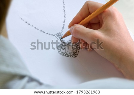 Drawing Jewelry Design. Drawing sketch jewelry on paper . Design Studio. Creativity Ideas. Photo stock ©