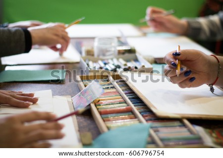 Drawing lesson for children and adults. Pastel pencils. Beautiful pastel picture. many people. Box with pencils on the table. Many materials. #606796754