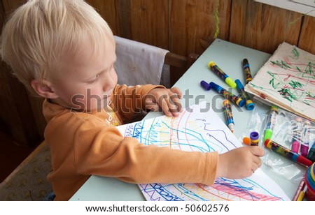 drawing little boy, sit at the table