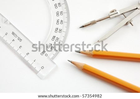 Drawing material - pencils,trammel,protractor on white background