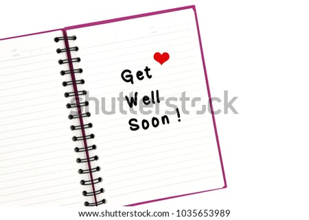 "Drawing of a red heart and wording "" Get well soon"" with handwriting isolated on blank line notebook.Flat lay,easy to use with clipping path.Copy space for text. #1035653989"