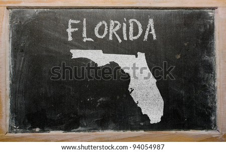 drawing of american state of florida on chalkboard, drawn by chalk - stock photo
