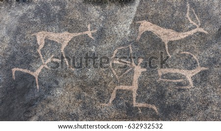 Drawing of an ancient man in a cave. Bronze age. archeology. Ancient animals. Ancient hunting. Era. era. period. Rock carvings.