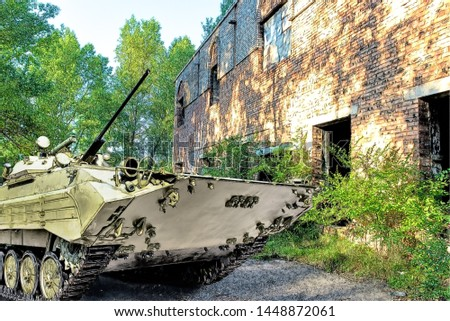 Drawing of an armored troop-carrier on background ruined building.