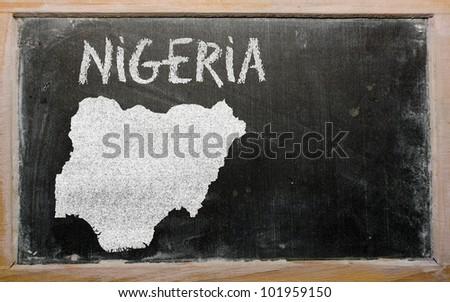 drawing of nigeria on blackboard, drawn by chalk