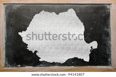 drawing of romania on chalkboard, drawn by chalk - stock photo