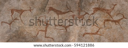 drawing on the wall in a cave, the rock. red ocher paint. Prehistoric man preys on animals deer. neanderthal, primitive, caveman, stone age, ice age.