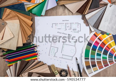 Drawing plan house with a palette of colors pencil brush on wooden background - Shutterstock ID 590534777