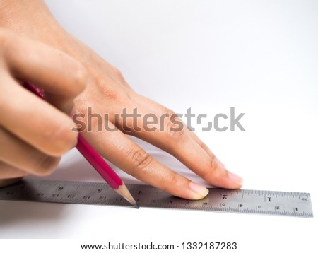 Drawing straight line with pencil and ruler #1332187283