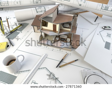 drawing table of an architect with the plans and 3d sectional model of a house