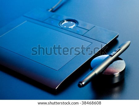 drawing tablet in blue light closeup