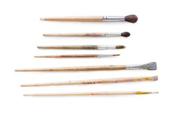 Drawing tools, set of dirty paint brushes in row on white isolated background, copy space, top view