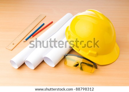 Drawings and hard hat on the desk