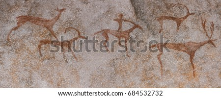 Drawings in a cave on the wall, painted with ocher rock. Primitive man, primitive Neanderthal. The hunter hunts a deer. Stone Age, Ice Age. Caveman.