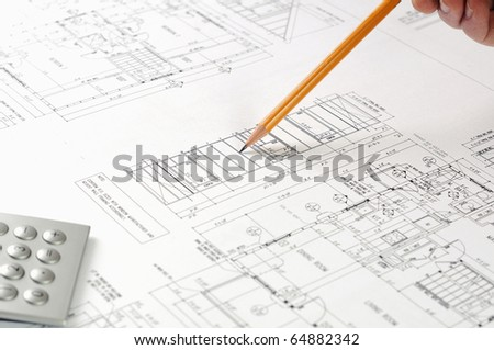 drawings of building homes and Tools with pen - stock photo