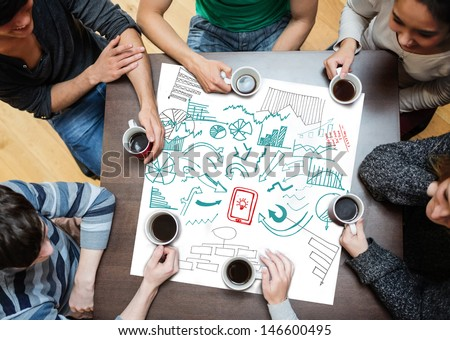 Drawings of charts and arrows drew on a poster during a brainstorm