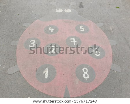 Drawings on Pavement - Picture of a Ladybug  on Asphalt - Playing with Numbers from One to Eight - Childhood - Learning Games For Kids