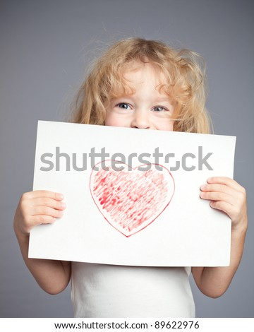 Drawn heart in baby hands. Valentine`s day concept